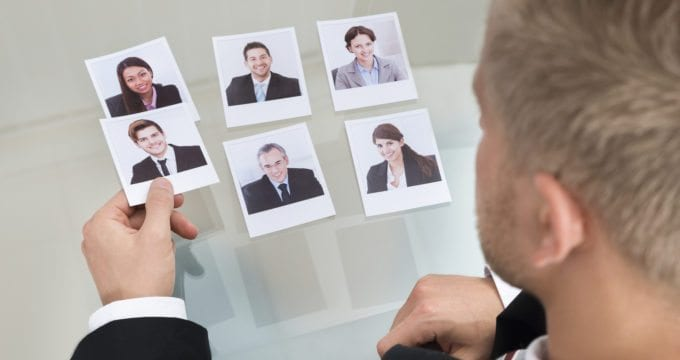 Close-up Of Businessman Choosing Candidate In Office